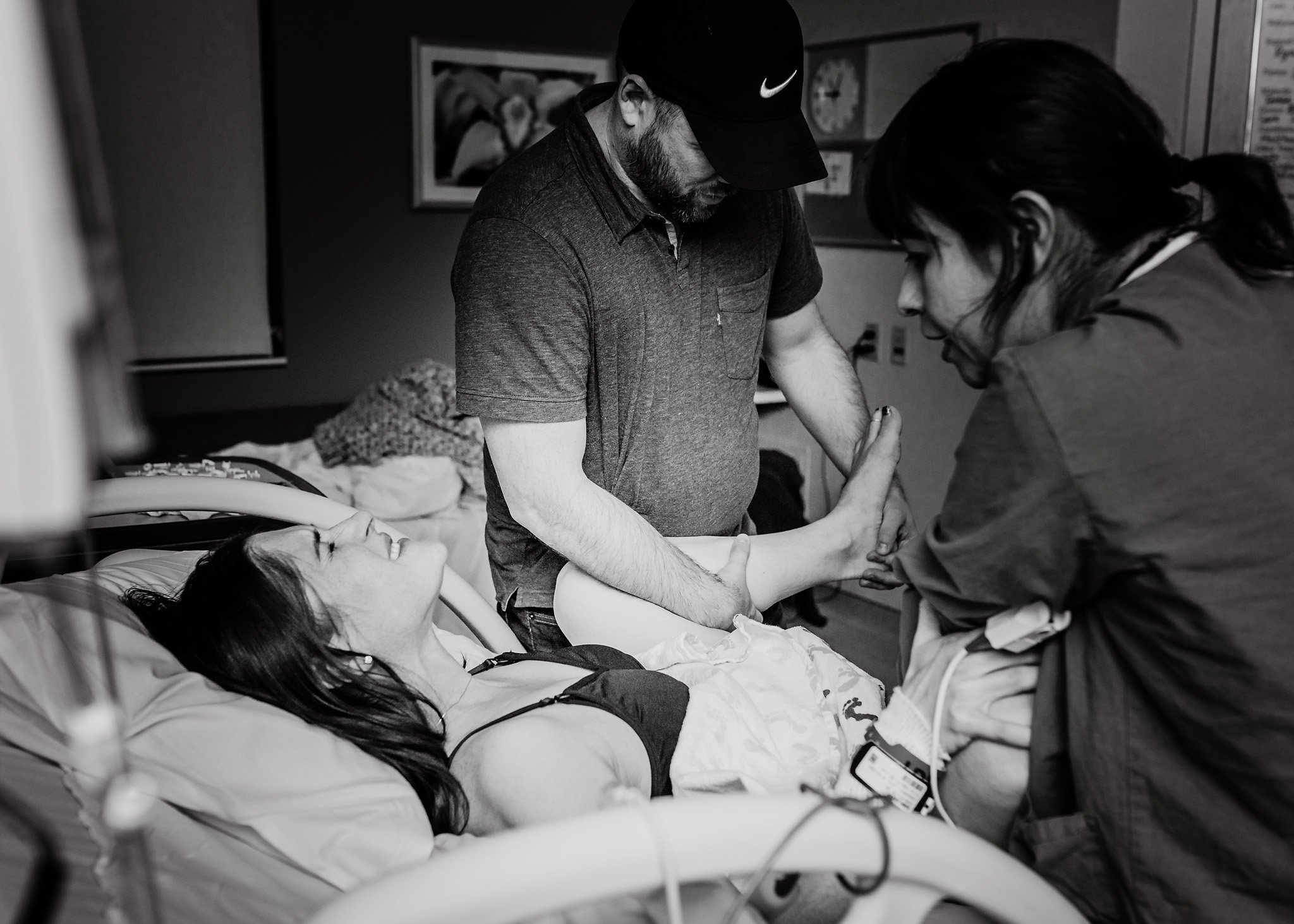 Beautiful birth photo of mother in labor pushing